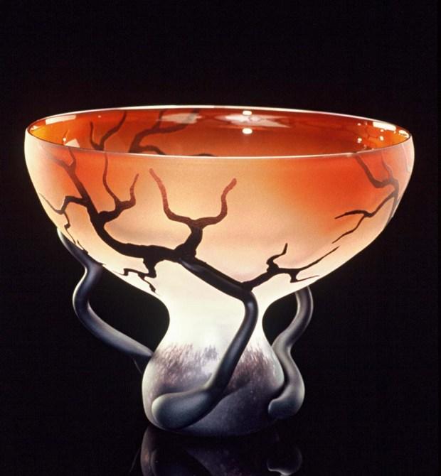 Chalice Root vessel in sunset salmon is a hand blown glass vessel by Bernard Katz.